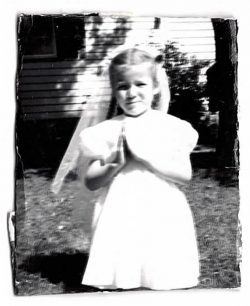 Inez Kelly celebrates her first Holy Communion as a young girl.