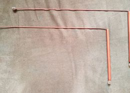 A pair of copper dowsing rods.